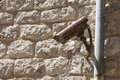 Surveillance camera outdoor with ancient stone wall background Royalty Free Stock Image