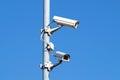 Surveillance cameras against blue sky Security Cctv