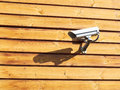 Surveillance cameras on wooden wall Royalty Free Stock Image