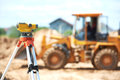 Surveyor equipment level at construction site Royalty Free Stock Photo