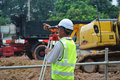 Surveyor using survey equipment at construction site selangor malaysia july the in selangor malaysia Stock Photos