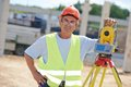Surveyor worker with theodolite portrait of builder transit equipment at construction site outdoors during work Royalty Free Stock Images