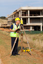 Surveyor working construction middle aged land at site Royalty Free Stock Image