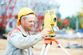 Surveyor works with theodolite one worker working transit equipment at road construction site outdoors Royalty Free Stock Photography