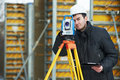Surveyor works with theodolite one worker working transit equipment at road construction site outdoors Stock Photos