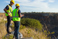 Surveyors mining site two male working at Royalty Free Stock Photo