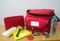 Survival kit emergency for in case of disaster including water first aid lighter bags utility knife and others Stock Photography