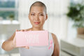 Survive woman suffering from breast cancer showing plate with inscription Stock Images