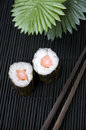 Sushi on bamboo mat with chopsticks black Stock Photos