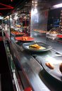 Sushi bar restaurant a with running Royalty Free Stock Images