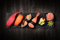 Sushi on black stone plate Royalty Free Stock Photo