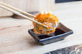 Sushi California rolls dipping sauce with chopsticks Japanese food Royalty Free Stock Photo