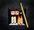 Sushi With Caviar and Sashimi on Black Plate with Chopsticks Royalty Free Stock Photo