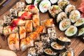 Sushi choice board with various nigiri futomaki hosomaki and uramaki rolls japanese cuisine Stock Image