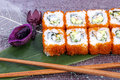 Sushi and chopsticks on green sheet the top view Royalty Free Stock Image