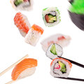 Sushi chopsticks isolated over white background Royalty Free Stock Image