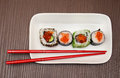 Sushi chopsticks selection of served on white plate with Royalty Free Stock Photography