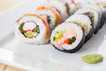 Sushi close up of plate full of fresh rolls Stock Image