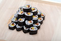 Sushi fresh maki rolls isolated on wooden board Stock Images