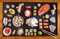 Sushi and ingredients on dark background Royalty Free Stock Photo