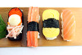Sushi made ​​from seafood on the white background is a food of japanese Royalty Free Stock Photography