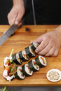 Sushi master prepares futomaki Royalty Free Stock Photo