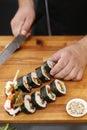 Sushi master prepares futomaki Royalty Free Stock Photo