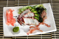 Sushi menu sliced octopus, cucumber and seaweed Royalty Free Stock Photo