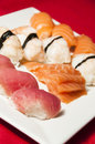 Sushi mix on a plate red background Stock Photo