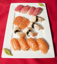 Sushi mix on a plate red background Stock Image