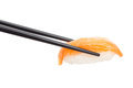 Sushi nigiri with black chopsticks Royalty Free Stock Photo