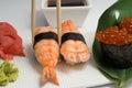 Sushi nugiri with shrimp amd gunkan with ikura on bamboo list ginger wnd wasabi Stock Image
