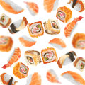 Sushi pieces flying on white background Royalty Free Stock Photography
