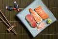 Sushi plate assorted prawn salmon and tuna with ginger and wasabi on bamboo matt Royalty Free Stock Photos