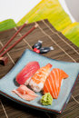 Sushi plate assorted prawn salmon and tuna with ginger and wasabi on banana leaf Stock Photos