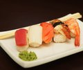 Sushi on the plate white Royalty Free Stock Photography