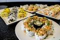 Sushi platter with salmon, mango, avocado served on white plate Royalty Free Stock Photo