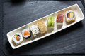 Sushi platter top view of dish with menu assorted on the table restaurant Stock Photos