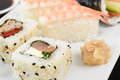 Sushi platter uramaki tuna teriyaki and red pepper salmon soft cheese and chives ebi nigiri and temaki served with wasabi japanese Royalty Free Stock Images