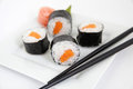 Sushi with rice and carrot on white plate Stock Photography