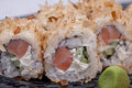 Sushi roll on black plate close up Stock Photo