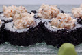 Sushi roll on black plate close up Stock Photos