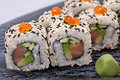 Sushi roll on black plate close up Royalty Free Stock Image