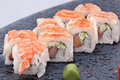 Sushi roll on black plate close up Royalty Free Stock Photos