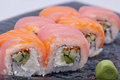 Sushi roll on black plate close up Stock Image