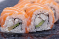 Sushi roll on black plate close up Royalty Free Stock Photography