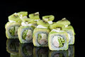 Sushi Roll with crab meat, kiwi and avocado over  black backgrou Royalty Free Stock Photo