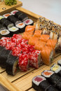 Sushi roll made dish in bamboo sticks Royalty Free Stock Photography