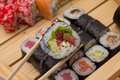 Sushi roll made dish in bamboo sticks Stock Photos