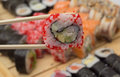 Sushi roll made dish in bamboo sticks Stock Image